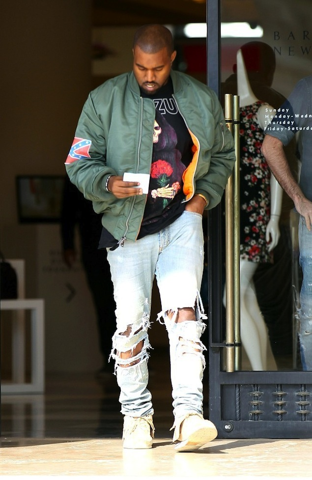 Kanye-West-Leaves-Barneys-NY-wearing-Yeezus-Tour-Flight-Bomber-Jacket-and-Tee-destroyed-denim-jeans-and-Visvim-Sneakers