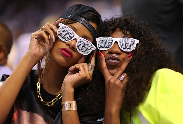 Rihanna-wears-Fukk-hat-Givenchy-tee-shirt-Air-Jordan-sneakers-courtside-with-Melissa-Forde-at-Miami-Heat-Playoff-Game